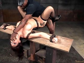 Two horny captors bonking Syren's shaved pussy in their dungeon