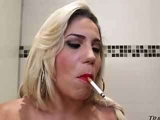 Big breasted light haired ladyboy Raphaella Cardoso masturbates in toilet