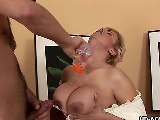 Alluring matured big tits doll giving monster cock titjob