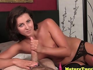 Dirty talking milf pulling hard juicy cock