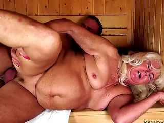 Plump granny in the sauna taking cock in her wet box