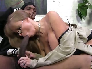 Big tittied cougar Darla Crane goes wild on hard black pole