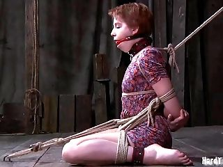 Bondage redhead slave having her ass spanked when tortured