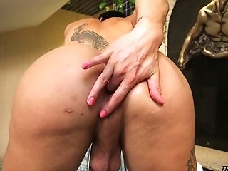 Big bottomed and fake tittied tranny Nicolly Lopes jerks off dick and finger fucks anal hole