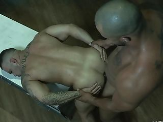 Buffed Latino gay man bends over his boyfriend for a rough fuck