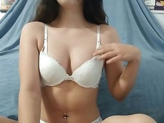 Teen playing with her boobs in white lingerie while mom and dad aren't home