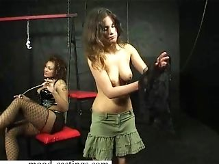 Kinky mistress enjoys hitting a lovely babe with a long whip